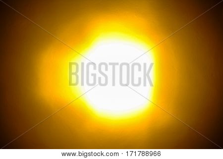 Abstract view of bright glowing light background with yellow and orange halos