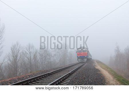 Gomel Belarus - 24 November 2013: The suburban diesel train moves on rails