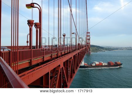 Cargo Ship Under The Bridge