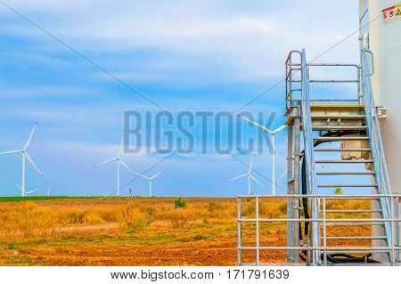 Electricity wind turbine tower generator with blue sky