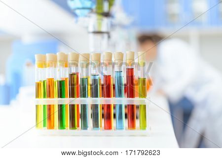 Close-up view of test tubes with reagents on white table in laboratory