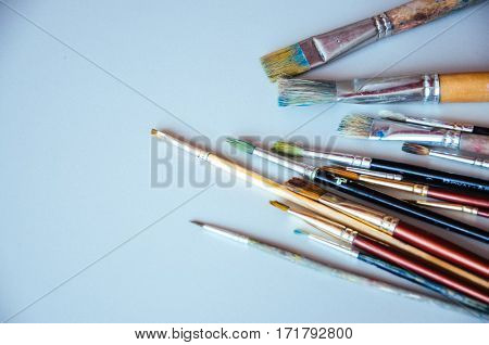 Paint brushes on a table. Painting concept.