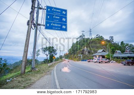 Mae Hong Son, Thailand - JAN 2, 2017: A Road from Mae Hong Son to Pai with traffic guide post in Mae Hong Son province, Thailand