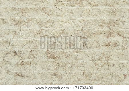 Beige granite wall background texture close up