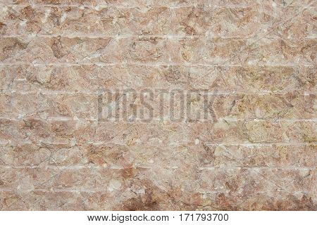 Red granite wall background texture close up