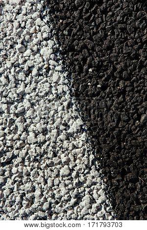 Asphalt road black with white markings. macro shooting.