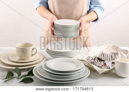 Closeup of female hands holding saucers