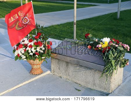 BALASHIKHA/ RUSSIA - MAY 9. Flowers at the memorial stone with the inscription Odessa on Victory Day on May 9, 2014 in city Balashikha, Moscow region, Russia.