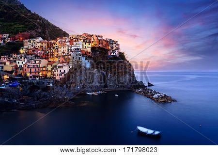 Manarola village at twilight. Manarola is a small town in the province of La Spezia Liguria northern Italy