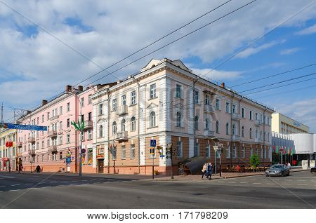 GOMEL BELARUS - MAY 1 2016: Unidentified people walk down street near crossroad of streets Lange and Sovetskaya Gomel Belarus