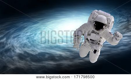 cosmonaut and spiral galaxy elements of this image furnished by NASA