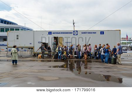 MOSCOW RUSSIA - JULY 18 2016: Unidentified passengers are on security checkpoint of Northern River Station awaiting landing on cruise ships Moscow Russia