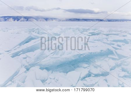 Turquoise Ice Floe. Ice-drift Of Baikal Lake. Winter Landscape.
