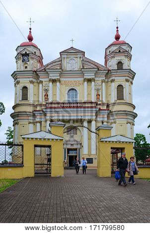 VILNIUS LITHUANIA - JULY 10 2015: Unknown people go from Catholic church of Holy Apostles Peter and Paul Vilnius Lithuania