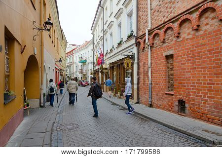 VILNIUS LITHUANIA - JULY 10 2015: Unknown people go along narrow Stikliu Street in Old Town Vilnius Lithuania