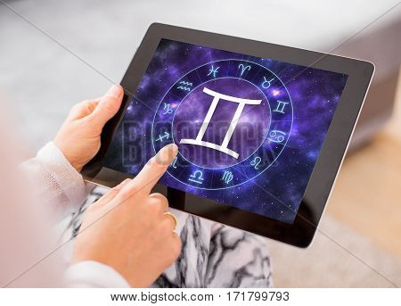 Gemini zodiac sign on tablet computers screen