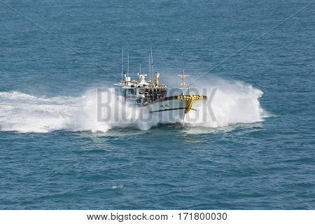 Busan South Korea - March 1th 2016: Busan anchorage of sea vessels the fishing vessel in splashes from high speed.