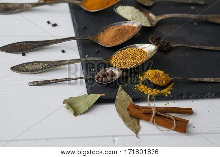 Spoons With Different Colored Spices