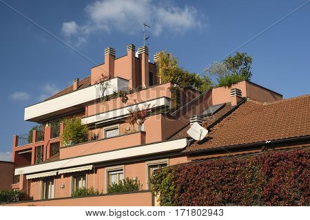 Milan (Lombardy Italy): residential buildings with plants and flowers along via Piero della Francesca