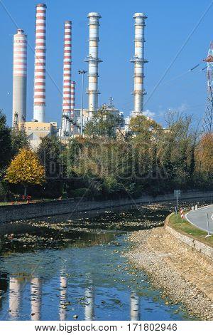 Turbigo (Milan Lombardy Italy): industrial chimneys along the Naviglio Grande