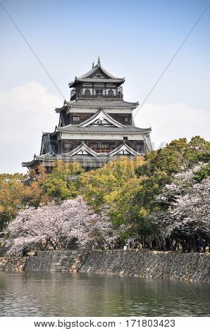 Hiroshima castle on the side of Otagawa river in spring Hiroshima Prefecture Japan