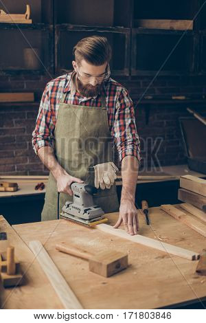 Handsome Young Man With Glasses And Hairstyle Has Serious Hobby. Cabinetry Grinds Wooden Plank At Hi