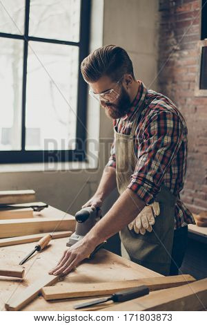 Serious  Joiner Work At His Workstation. Successful Handsome Businessman With Stylish Hairstyle And