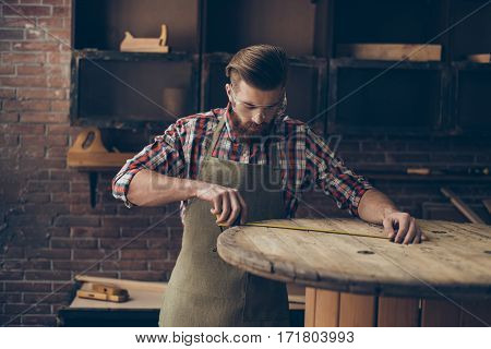 Serious Handsome  Craftsman Work With Ruler. Stylish Young Cabinet-maker With Brutal Hairstyle And S