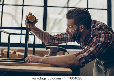 Closeup Side View Photo Of Handsome  Worker With Ruler. Stylish Young Entrepreneur With Brutal Hairs