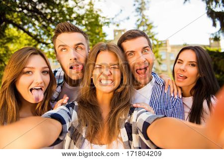 five crazy best friends fooling and making funny selfie photo