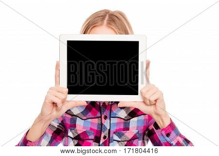 Shy Woman Hiding Face Behind Black Screen Of Tablet