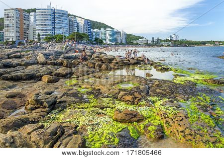 VILA VELHA BRAZIL - DECEMBER 25th 2016 ; Tourists on a crowded Mermaid Beach in Vila Velha state of Espirito Santo Brazil.