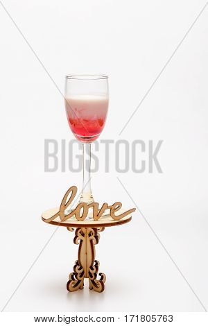 Alcohol Coctail Singapore Sling On Decorative Table With Love Inscription