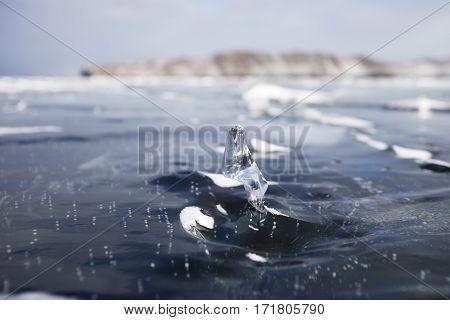Transparent Ice floe. Winter landscape. Baikal lake
