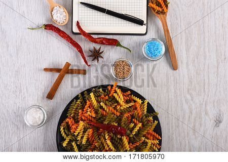 Colorful Italian Pasta And Open Notebook With Pen