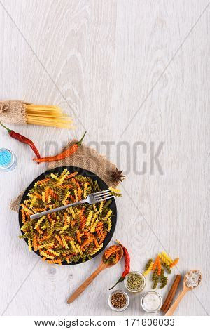 Dried Colorful Italian Pasta With Fork And Spoons