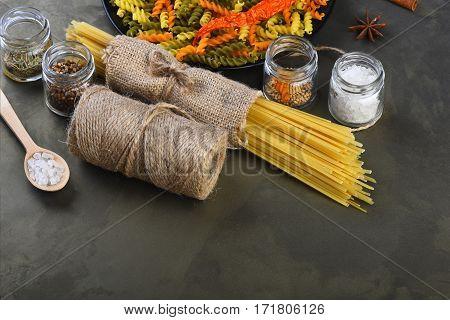 Bunch Of Spaghetti Pasta And Fusilli With String Bobbin