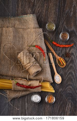 Bunch Of Spaghetti And String Bobbin On Sackcloth