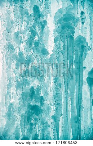 Big blue icicles - detail. Wintertime. Frozen water