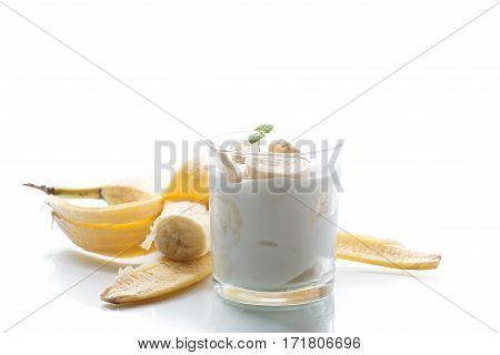 yogurt with bananas on a wtite background