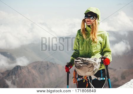 Woman climbing on mountain summit Travel Lifestyle adventure concept active vacations outdoor mountaineering sport success happiness emotions