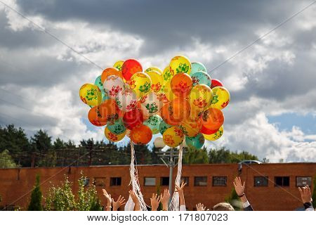 Bunch of balloons rising into the sky at the celebration of the beginning of the new school year in Russia.