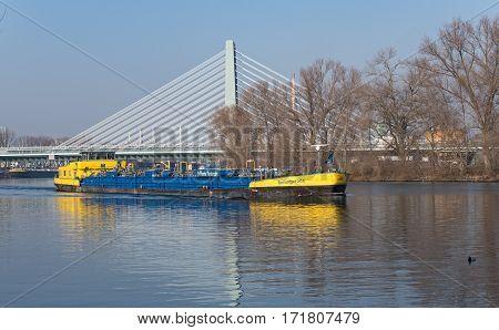FRANKFURT, GERMANY,FEBRUARY 16, 2017: Blue-yellow tank ship on the Main river near Frankfurt