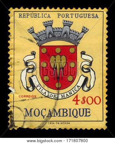 Portuguese Mozambique - circa 1961: A stamp printed in Portugal shows coats of arms of Vila de Manica, province of Mozambique, circa 1961