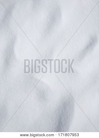 View of snow texture, abstract natural background with copy space. Mobile photography.