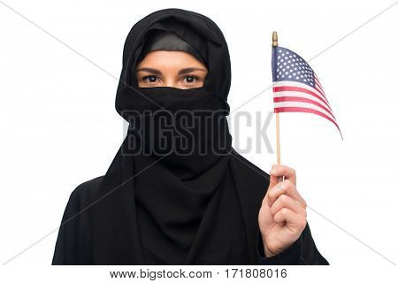 immigration and people concept - muslim woman in hijab with american flag over white background
