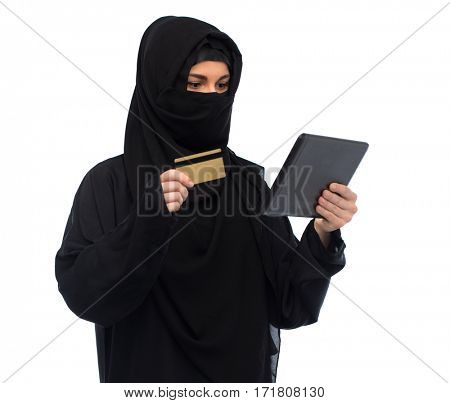 finances, technology, online shopping and people concept - muslim woman in hijab with tablet pc computer credit card over white background