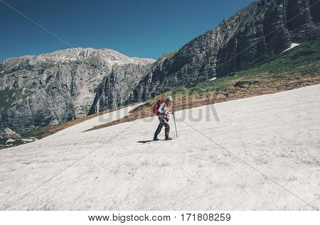 Traveler climbing on mountains glacier with backpack Travel Lifestyle concept adventure active summer vacations outdoor into the wild