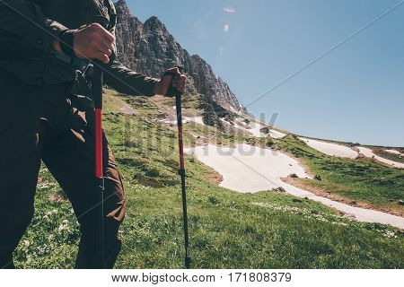 Traveler Feet hiking in mountains with trekking poles Travel Lifestyle adventure active summer vacations outdoor concept