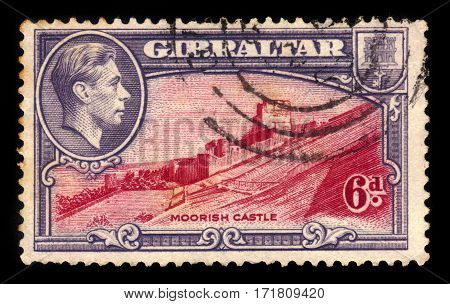 GIBRALTAR - CIRCA 1938: A stamp printed in Gibraltar shows Moorish Castle, medieval fortification in Gibraltar, circa 1938